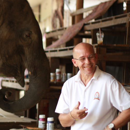 Elephant Camp, Arts by Elephants Suda the Elephant Artist Painting on Canvas with Mae Taeng Elephant Camp Owner Ken Chailert.